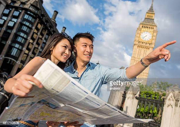 Asian tourists sightseeing in London with a map