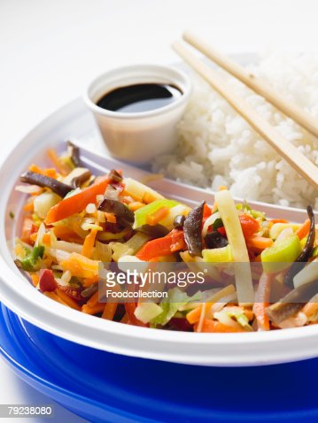 Asian vegetable stir-fry with rice : Stock Photo