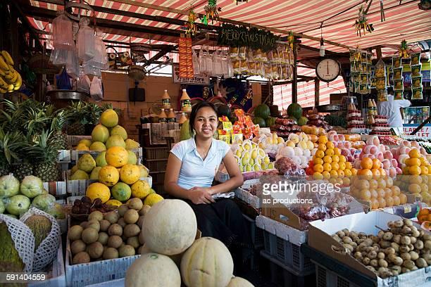 Asian vendor smiling at market