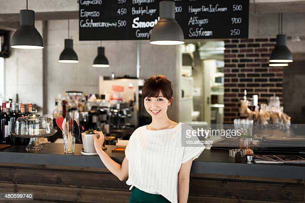 Asian waitress in a cafe