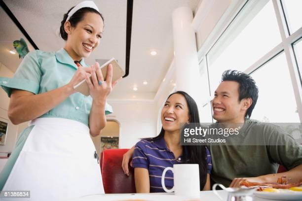 Asian waitress taking order at diner
