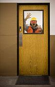 Asian warehouse worker yelling through door