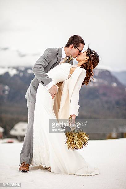 Asian Woman and Caucasian Man Wedding in Snow Mountains