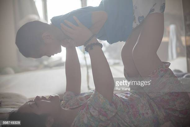 Asian woman and child do yoga