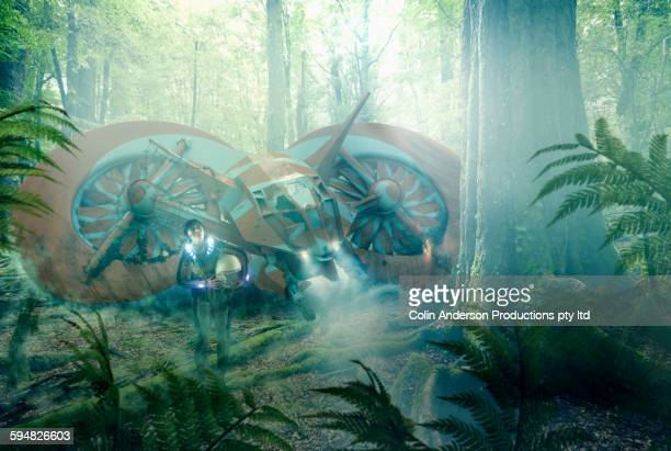 Asian woman and stranded spaceship in jungle