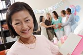 Asian woman at a Baby Shower
