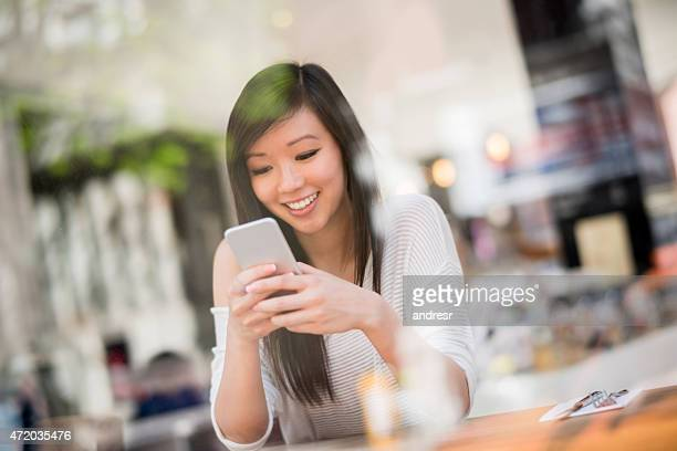 Asian woman at a coffee house