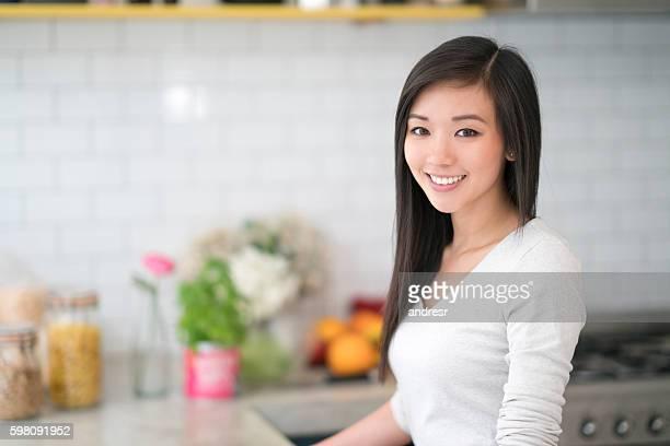 Asian woman at home