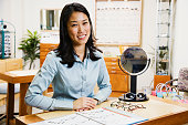 Asian woman at optometrist?s office