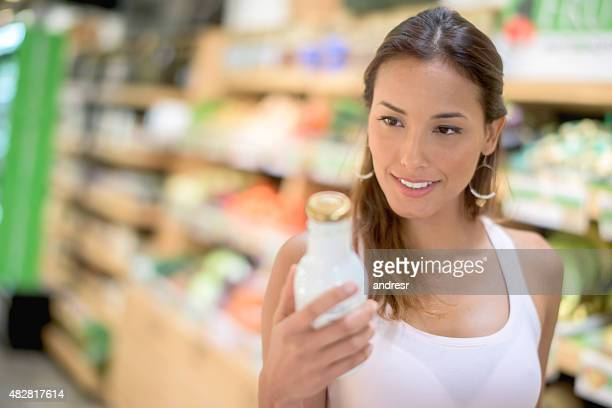 Asian woman buying a drink at the supermarket