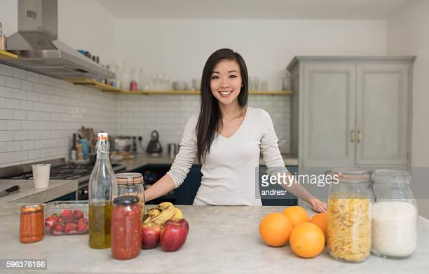 Asian woman cooking at home