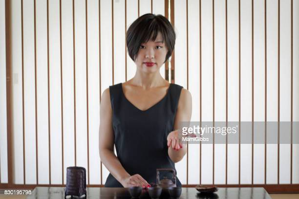 Asian woman doing Chinese tea ceremony