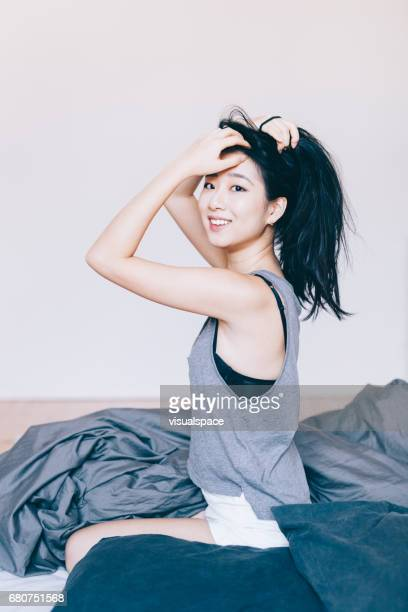 Asian Woman Doing Her Hair