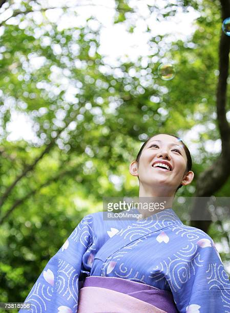Asian woman dressed in yukata smiling