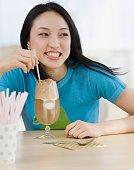Asian woman drinking milkshake