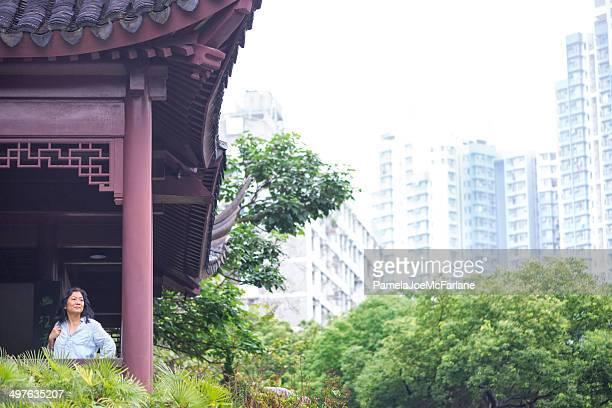 Asian Woman Enjoying the View at Kowloon Walled City Park