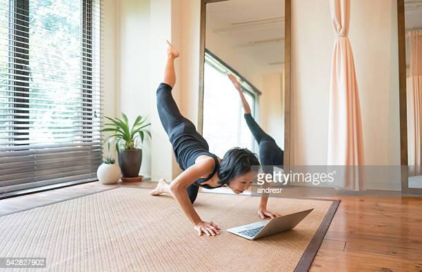 Asian woman exercising at home