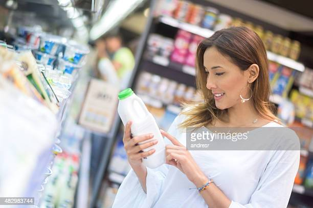 Asian woman grocery shopping at the supermarket