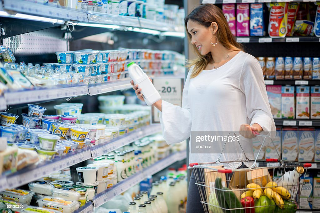Asian woman grocery shopping