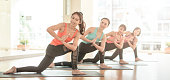 Asian woman group exercising do yoga in yoga classes