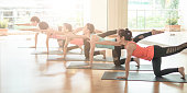 Attractive young Asian woman group exercising yoga  in yoga classes
