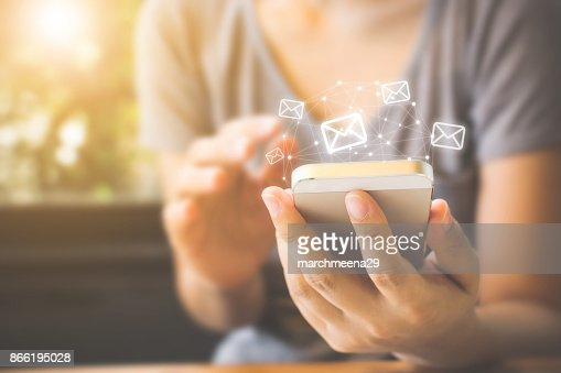 Asian woman hand using mobile phone with e-mail application, Concept email and newsletter : Stock Photo