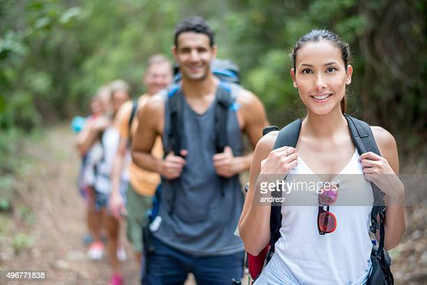 Asian woman hiking with some friends