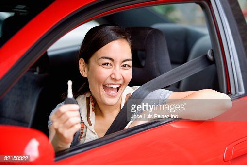 Asian woman holding  car key in car : Stock Photo