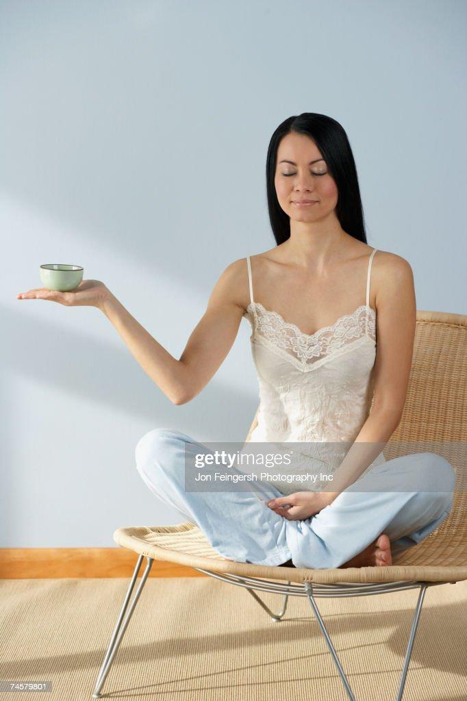 Asian woman holding tea cup : Stock Photo