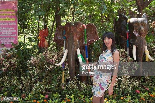 Asian woman holding tusk of elephant tusk : Stock Photo