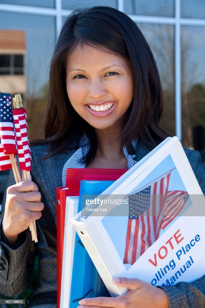 Asian woman holding voting binder : Stock Photo