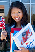 Asian woman holding voting binder