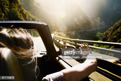 Asian woman in convertible car : Stock Photo