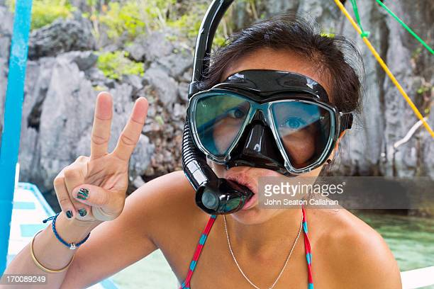 Asian woman in dive mask with snorkel.