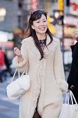 Asian woman in urban scene
