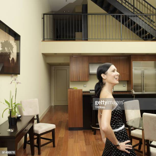 Asian woman laughing indoors