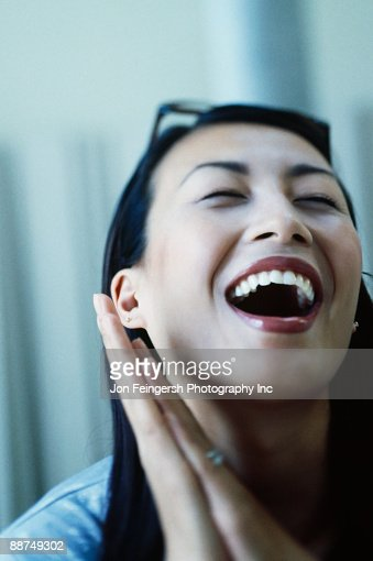 Asian woman laughing : Stock Photo