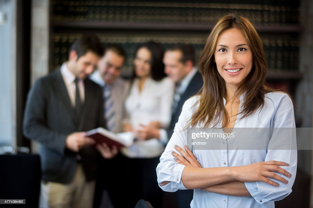 Asian woman leading a group : Stock Photo