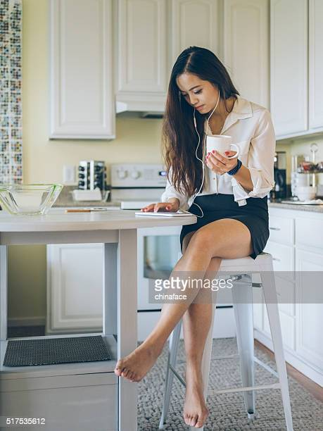 asian woman listening music with tablet pc