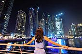 Asian woman looking the cityscape of Dubai