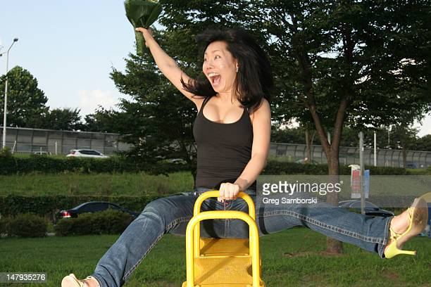 Asian woman on a seesaw
