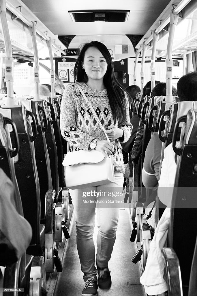 Asian woman on bus, Hong Kong