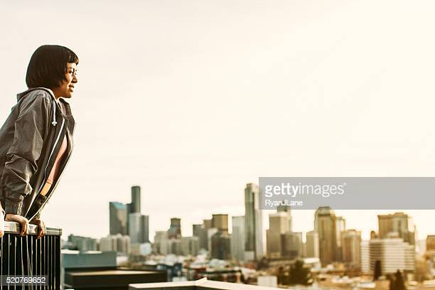 Asian Woman On Seattle Rooftop with Skyline