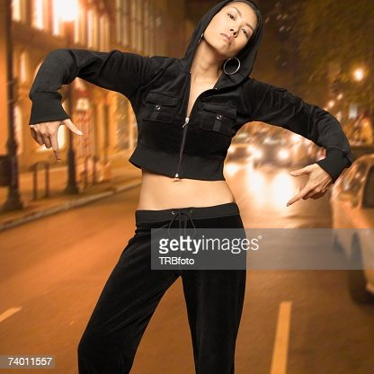 Asian woman posing in street