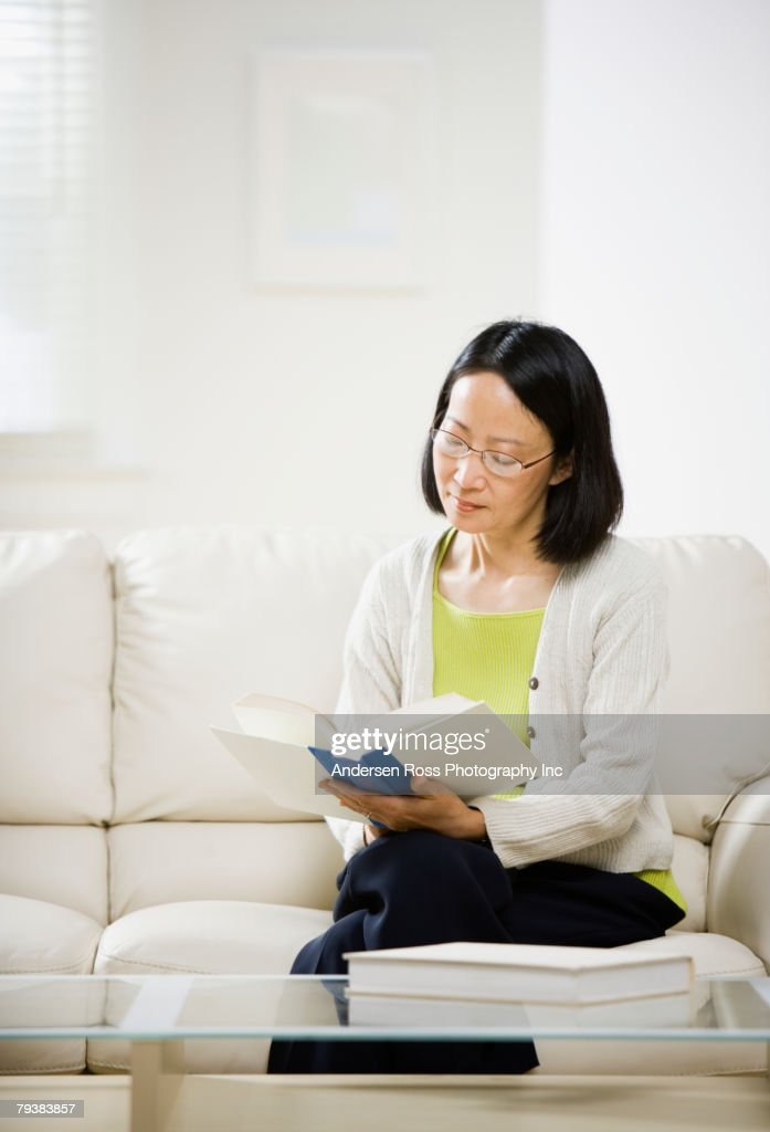 Asian woman reading book : Stock Photo