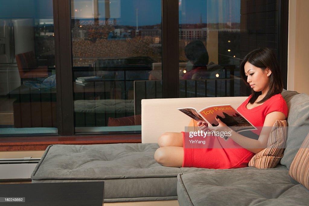 Asian Woman Reading Magazine On Sofa, Inside Apartment At Night : Stock  Photo