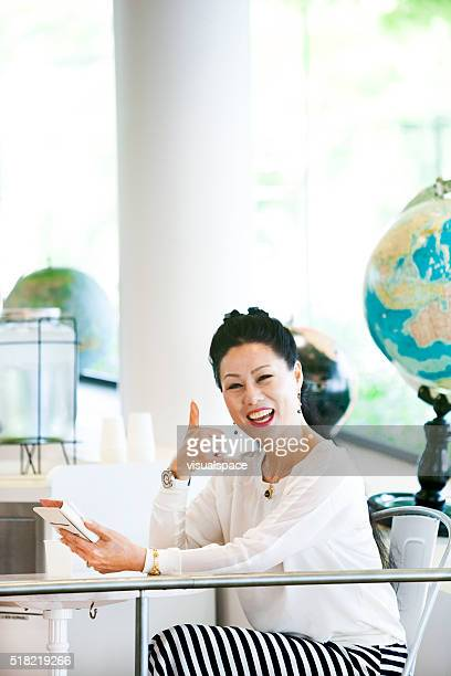 Asian Woman Ready To Call Up Her Social Network Friends
