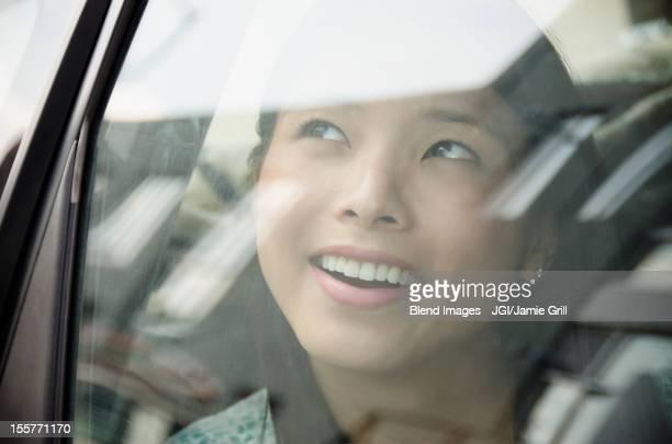 Asian woman riding in car