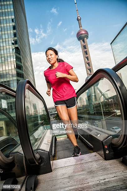 Asian Woman Running Stairs in Urban City