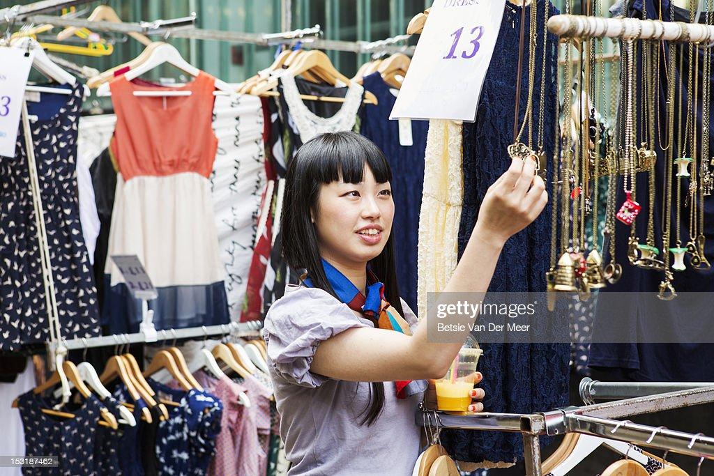Asian woman shopping at marketstall. : Stock Photo